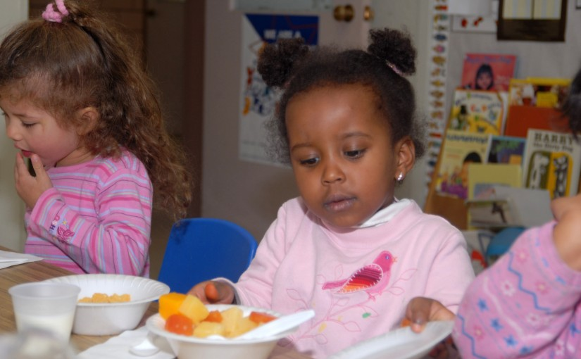 Youngsters at the Higher Horizons Day Care Center in Bailey Crossroads, VA receive healthy food and snacks on October 25, 2006 under the U.S. Department of Agriculture (USDA) Food Nutrition Service's (FNS) Child and Adult Care Food Program (CACFP) and Head Start program. CACFP plays a vital role in improving the quality of day care for children and elderly adults by making care more affordable for many low-income families. Each day, 3.2 million children receive nutritious meals and snacks through CACFP. USDA photo.